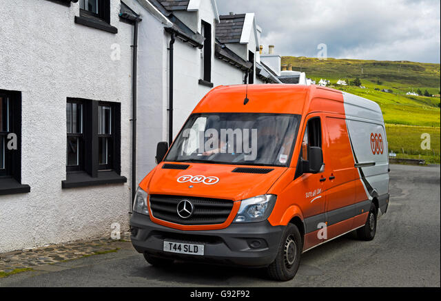 Van of the courier delivery services company TNT in Stein, Waternish peninsula, Isle of Skye, Scotland, Great Britain - Stock Image