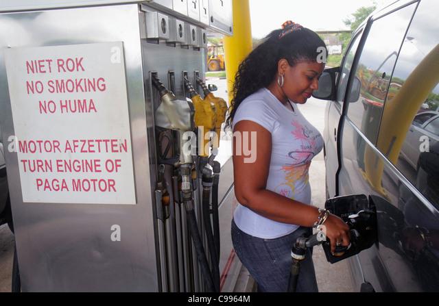 Curaçao Netherlands Antilles Dutch Weg Naar Westpunt petrol gas station fuel pump sign. safety no smoking turn - Stock Image