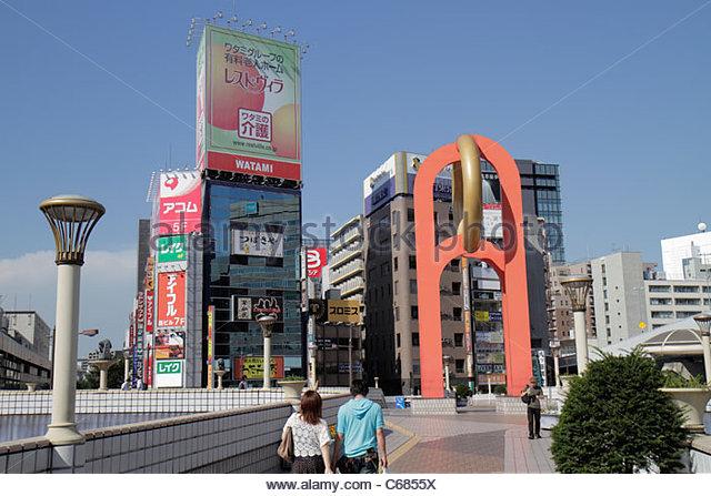 Japan Tokyo Ueno pedestrian walkover kanji hiragana katakana Japanese English characters symbols billboards advertising - Stock Image