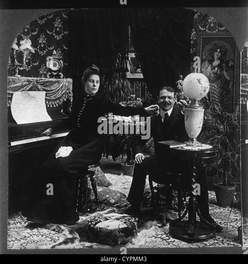 Man and Woman in Victorian Parlor, Stereo Photograph, Circa 1900 - Stock Image