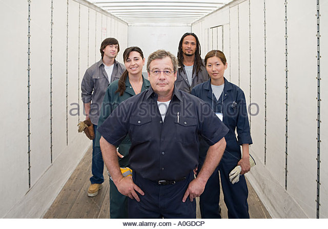 Fünf Arbeiter Stockbild