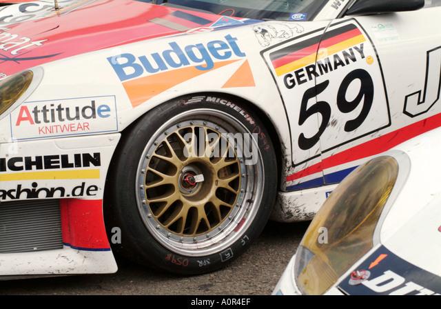 Porsche-Sponsor Werbung Rad Reifen Slick racing Auto motor und Sport Auto Risiko Sieg verlieren Geschwindigkeit Stockbild