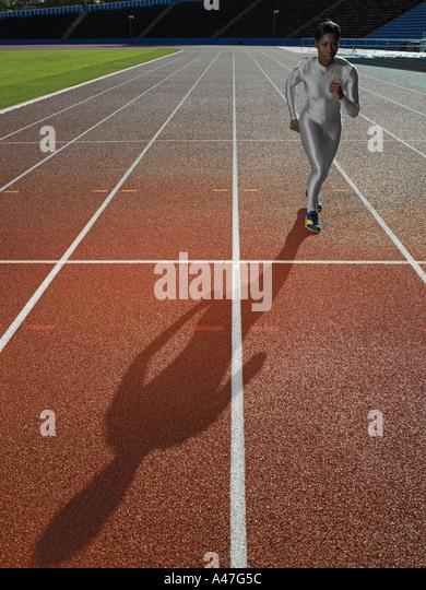 Weibliche Läufer auf Rennstrecke Stockbild
