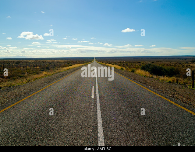 Geraden Straßen ins Nirgendwo Stockbild