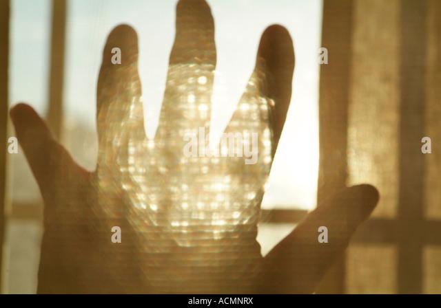 Hand und Sonnenlicht in einer collage Stockbild