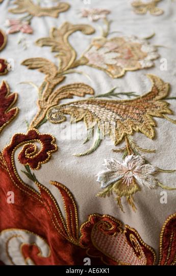 bestickte antike Tischdecke Stockbild