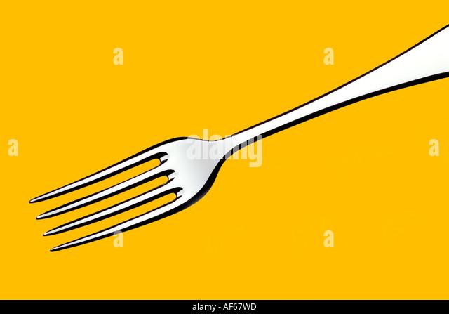 Gabel gelb hinterlegt Stockbild