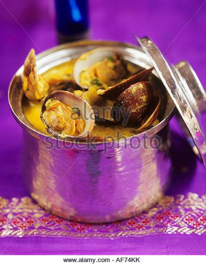 Muscheln in Soße aus Goa, Indien Stockbild