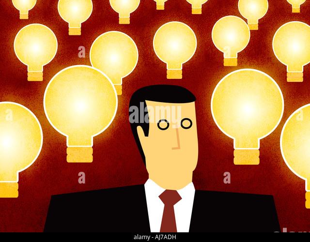 Business-Mann mit Ideen - Mann mit Glühbirne Stockbild