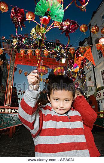 Kinder feiert Chinesisches Neujahr Stockbild