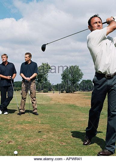 Golfspieler schwingen seines Vereins Stockbild