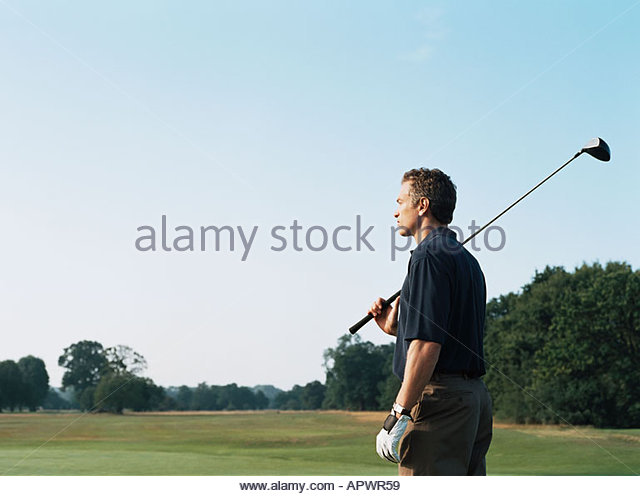 Golfer mit Golfclub auf seiner Schulter Stockbild