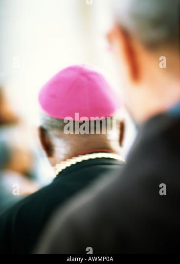 Priester, Rückansicht Stockbild