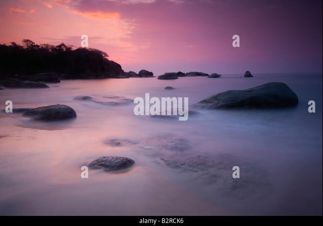 Sonnenuntergang am Agonda Beach, Süd-Goa, Indien Subkontinent, Asien Stockbild