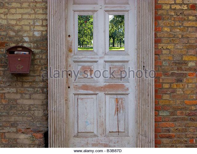 Altmodische Tür und Backstein Haus Stockbild