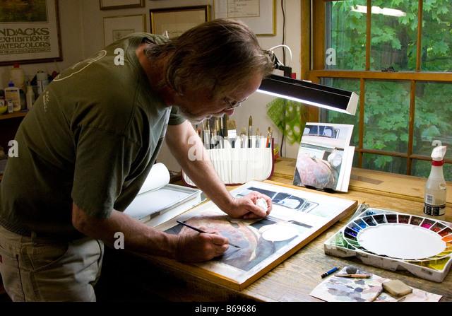 Aquarell Künstler bei der Arbeit Stockbild