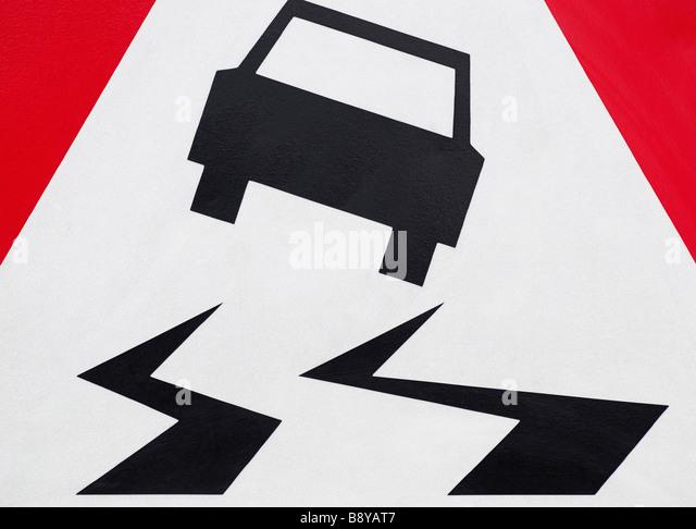 Rutschige Straße Zeichen Stockbild