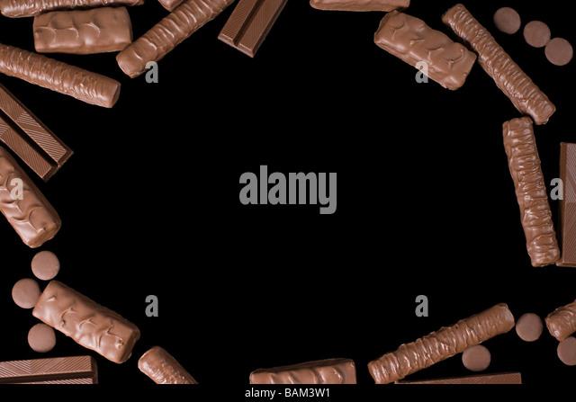 Schokoladenkekse auf schwarzem Hintergrund Stockbild