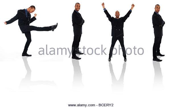 glückliche Gewinnerin Geschäftsmann tanzen auf weißen Posen Stockbild