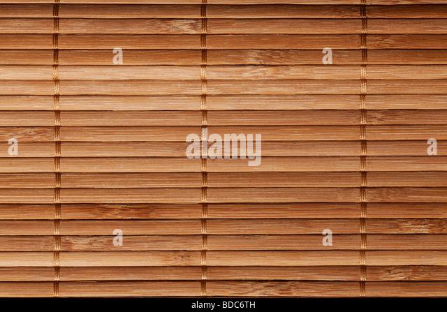 natürlichem Bambus Lattenrost Matten Hintergrund in Brauntönen Stockbild