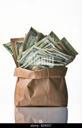 Beutel mit Geld auf weißem Hintergrund Stockbild