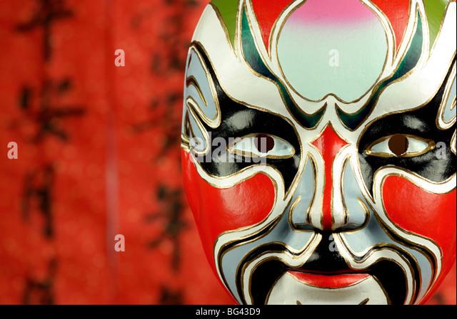 Beijing Oper Masken auf einem festlichen Hintergrund. Stockbild