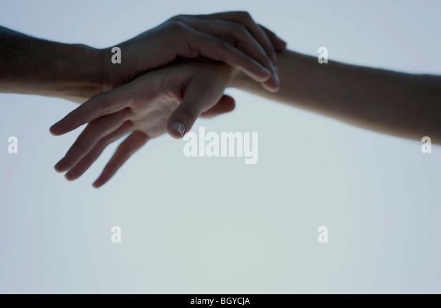 Hände berühren, halten Handgelenk Stockbild