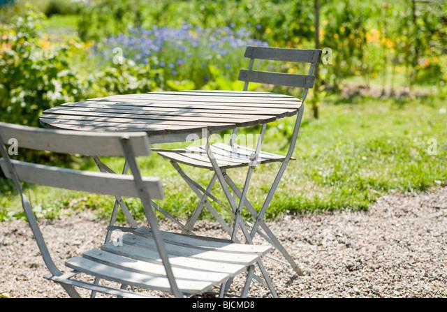 Patio-Möbel im Garten Stockbild
