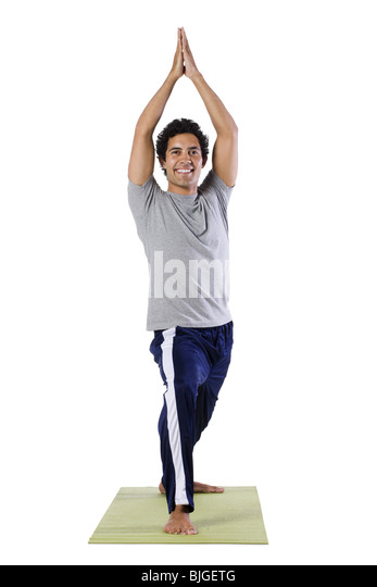 Mann tut yoga Stockbild