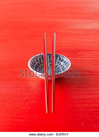 Asien China Schüssel mit Stäbchen Stockbild