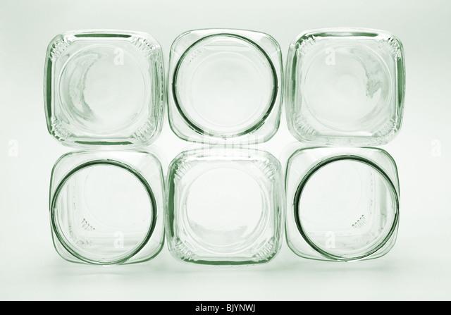 Stapel von leeren Glasbehälter auf nahtlose Hintergrund Stockbild
