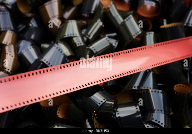 Spulen von unbebauten, generische 35mm Film emulsion, eine antiquierte Analogtechnik ersetzt durch das Pixel Digitalkamera Stockbild