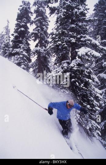 Mann Skifahren Seite Land Hang in Montana. Stockbild