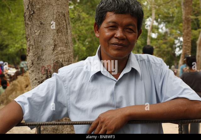 Tätowierte Mann am Dorffest, Siem Reap, Kambodscha Stockbild