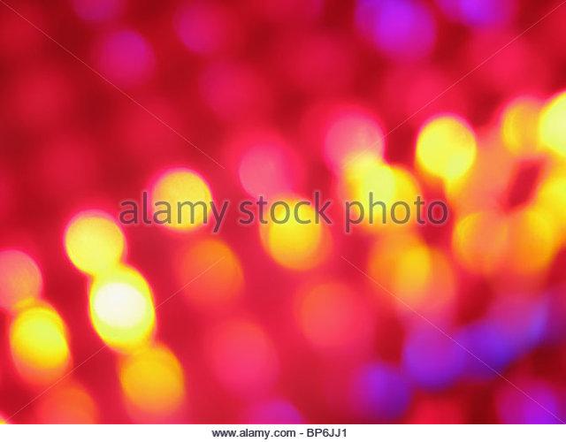Ein abstraktes Bild von lila, rosa und gelb leuchten Stockbild