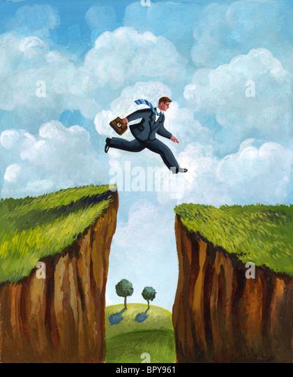 Ein Bild eines Geschäftsmannes quer über zwei Klippen Stockbild