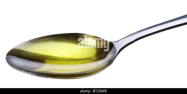 Löffel mit Olive isoliert auf einem weißen. Stockbild