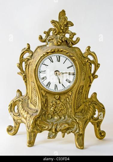 barocke Uhr isoliert in weiß dekoriert Stockbild