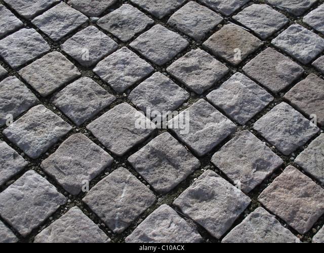 Kopfsteinpflaster oder Verbundpflaster in einem diagonalen Muster Stockbild