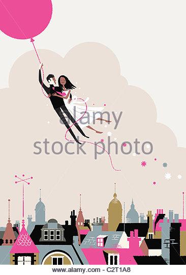 Braut und Bräutigam auf Helium-Ballon wegfliegen Stockbild