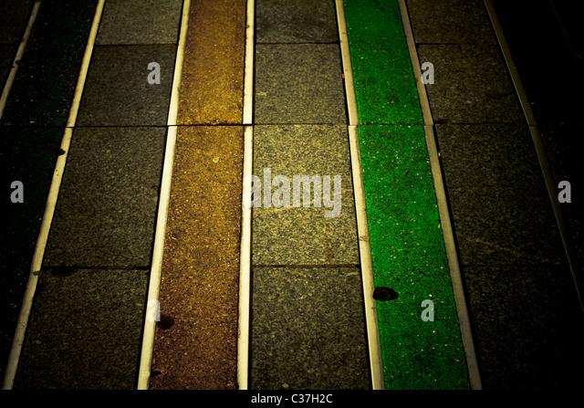Farbige Muster auf dem Bürgersteig. Abstrakt. Stockbild