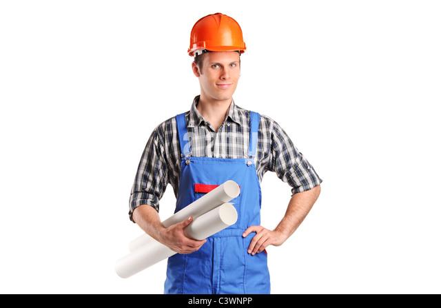 Ein Bauarbeiter Helm trägt und hält Blaupausen Stockbild