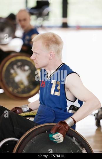 Para-Rugby-Spieler im Rollstuhl Stockbild