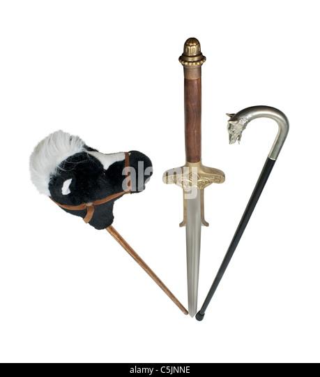 Phasen des Lebens dargestellt durch ein Hobby-Pferd, Schwert und einem silbernen Stock - Pfad enthalten Stockbild