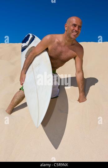 Surfer, die Spaß am Strand. Stockbild
