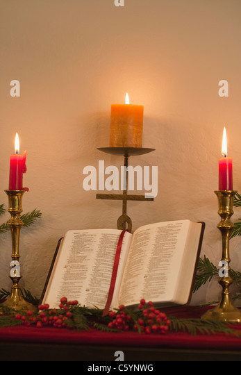 open bible candle stockfotos open bible candle bilder. Black Bedroom Furniture Sets. Home Design Ideas