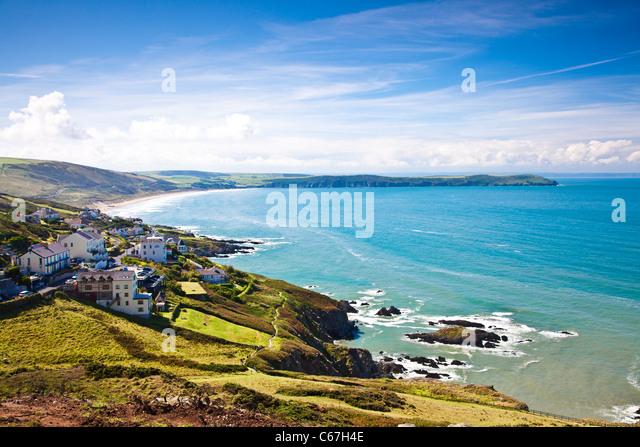 Blick über Woolacombe Bay in Richtung Baggy Point, North Devon, England, UK Stockbild