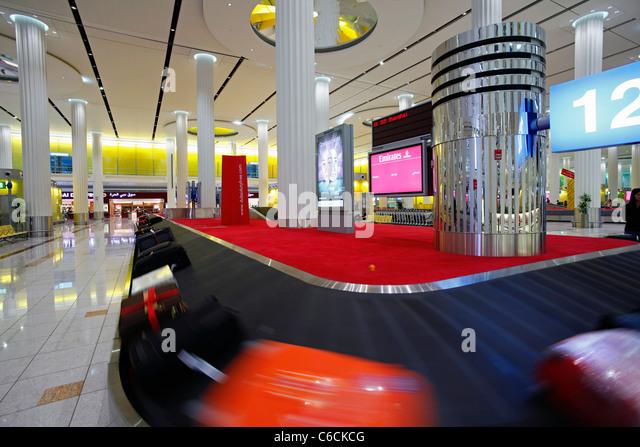 UAE, Vereinigte Arabische Emirate, Dubai, Dubai International Airport, Terminal 3, Gepäckband in der Ankunftshalle Stockbild