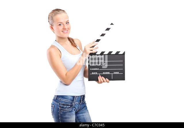 Ein fröhliches Mädchen hält ein Film Donnerschlag Stockbild