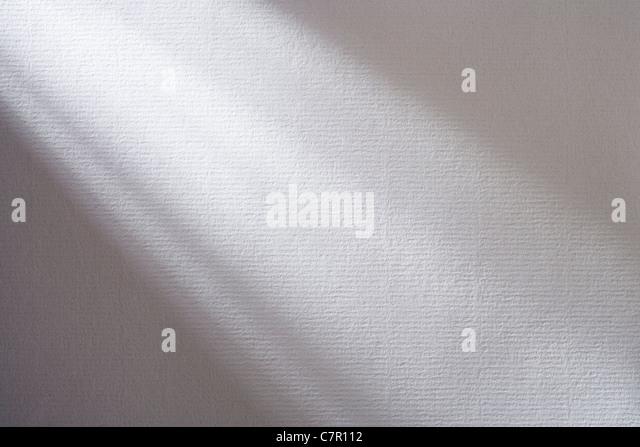 Schatten auf strukturiertem Papier. Stockbild